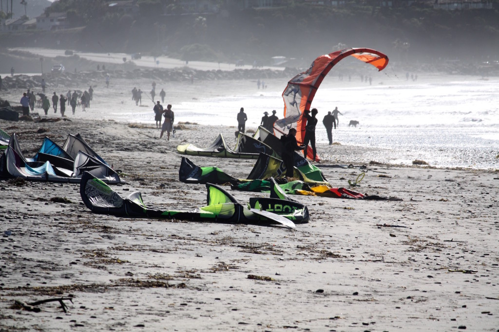 Kitesurfer setting up their kites and prepping for a great time in the wind at Cardiff Reef in San Diego.
